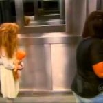 Girl scares persons by standing in elevator (Prank)