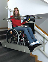 Girl sitting on a wheelchair platform lift